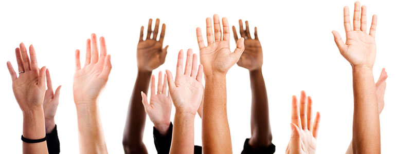 Multicolored hands raised to ask frequently asked questions